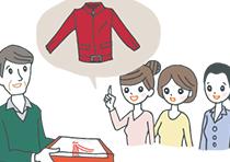 真っ赤なジャケットをプレゼントされている還暦の男性