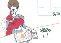 赤ちゃんをスリングでだっこしながらカタログを見ているママさん