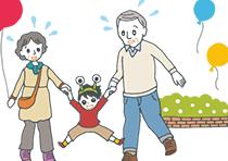 テーマパークで楽しく遊ぶ孫とおじいちゃん、おばあちゃん