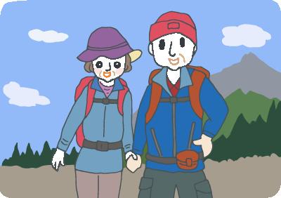 リュックを背負って山歩きの途中で記念撮影する、まだまだ元気な還暦の夫婦