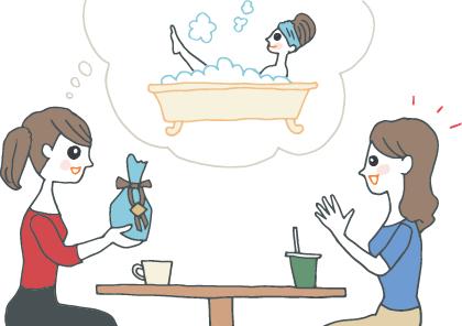 プレゼントを渡しながら、友人に使ってもらっているところ(バスタイムに、バスボムで泡風呂を楽しむようす)を想像する女性。